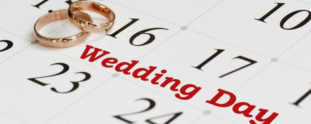 rings on calendar text wedding day